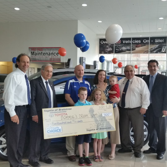 Toyota of Braintree Chairty Winner Accepting Gift